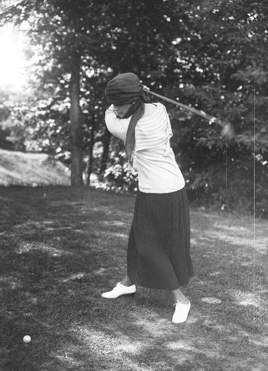 Minna Rider playing golf in France, 1920
